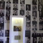 fall with photos of prisones, WWII memorial camp wall
